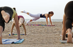 Girl training on the beach Stock Images