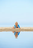Girl training on beach. Outdoor portrait of young beautiful blonde woman gymnast posing on the beach Stock Image