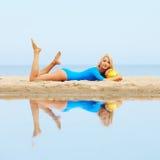 Girl training on beach Stock Photos