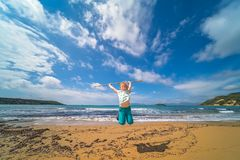 The girl training on the beach. The girl training with the long wooden stick on the beach in summer stock photos