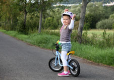 Girl on training bike Royalty Free Stock Photography