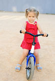 Girl on a training bike Royalty Free Stock Photography