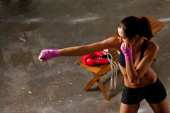 Girl training body combat Stock Image