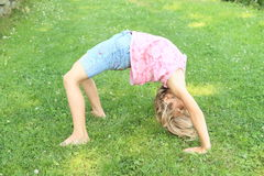 Girl training bridge Royalty Free Stock Photos