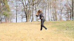 Girl training cartwheel stock video