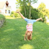 Girl training cartwheel Stock Images