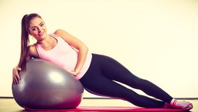 Girl exercising with fit ball Stock Photos