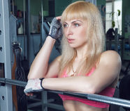 The girl is training in the gym Royalty Free Stock Photography