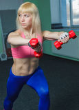 The girl is training in the gym Stock Photo