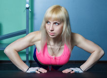 The girl is training in the gym Stock Images