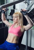The girl is training in the gym Royalty Free Stock Photo