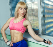 The girl is training in the gym Royalty Free Stock Image