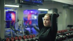 Girl Training in Hall Dumbbell Over Head stock video