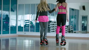 Girl training jumping with kangoo shoes in the dance studio stock video footage