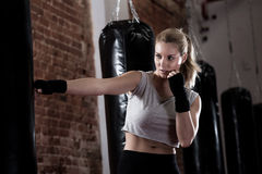 Girl training kick boxing Stock Images