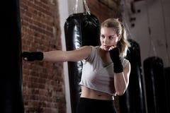 Girl training kick boxing. Horizontal view of girl training kick boxing Stock Images