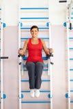 Girl on training machine Royalty Free Stock Image