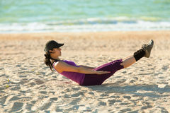 Girl training at the sea shore Royalty Free Stock Images