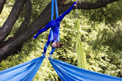 Girl training on silks on open air Stock Photography