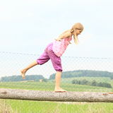 Girl training stability Stock Photo