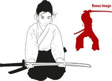 Girl training with sword. A little girl in a traditional Oriental sports kimono meditating before a sword Stock Photography