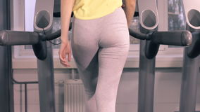 The girl Training On A Treadmill. The girl At The Gym Exercising On A Cross Trainer Treadmill Jogging Fitness Sport stock video