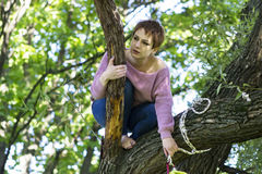Girl training on a tree on open air. Young gymnast doing exercise on a tree Royalty Free Stock Images