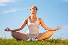 Girl training yoga Royalty Free Stock Image