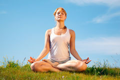 Girl training yoga Stock Images