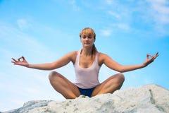 Girl training yoga Royalty Free Stock Photo