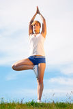 Girl training yoga Royalty Free Stock Photos