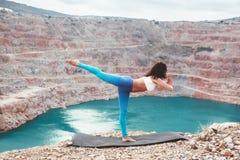 Girl training yoga pose outdoor Royalty Free Stock Photos