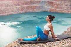 Girl training yoga pose outdoor Royalty Free Stock Photo