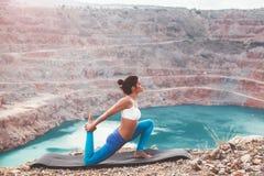 Girl training yoga pose outdoor Royalty Free Stock Image