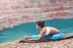 Girl training yoga pose outdoor Royalty Free Stock Photography