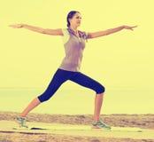 Girl training yoga poses Royalty Free Stock Image