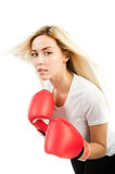Girl trains with boxing gloves Stock Photography