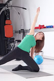 Girl trains fitness exercise Stock Images