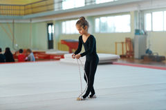 Girl trains with  rope in rhythmic gymnastics. Stock Image