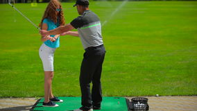 Girl trains to hit the ball in golf