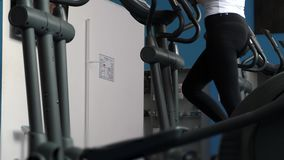 Girl trains on a treadmill. walking in the gym. fitness club woman engaged in walking. sports lifestyle concept. weight. Girl trains on a treadmill. walking in stock video footage