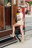 Girl, Tram and Sunflower Stock Images