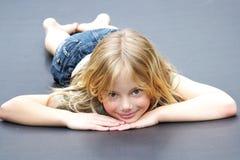 Girl on trampoline Stock Photos