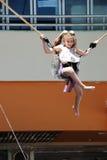 Girl in trampoline bungee harness, Benalmadena. Stock Photography