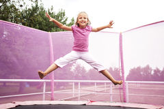 Girl Trampoline Jump Royalty Free Stock Images