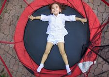 Girl in the trampoline Royalty Free Stock Images
