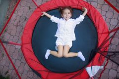 Girl in the trampoline Royalty Free Stock Photography