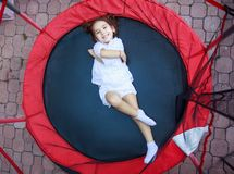 Girl in the trampoline Royalty Free Stock Image