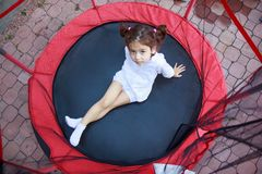 Girl in the trampoline Stock Photos