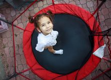 Girl in the trampoline Stock Image